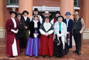 Museum volunteers dressed in colonial costume