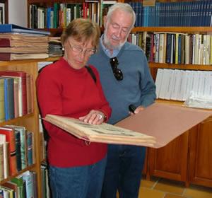 Historians read a copy of an historic newspaper